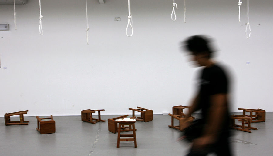 Visitor walks past LASALLE-SIA College of the Arts' Asian Art Camp URBANONURBAN exhibition in Singapore